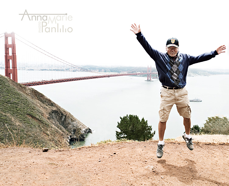 Dad jumps in front of the Golden Gate Bridge