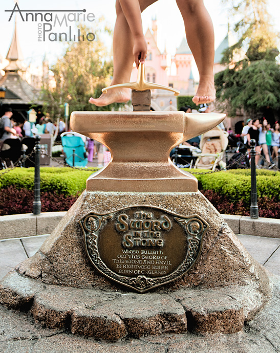 Maritess jumps over the Sword in the Stone at Disneyland