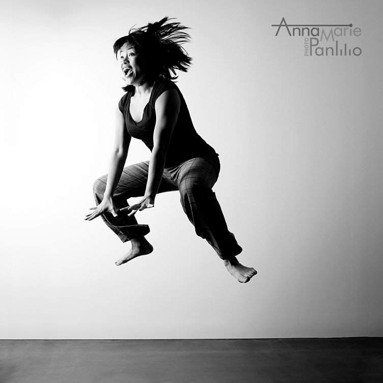 AM's signature froggy jump in black and white