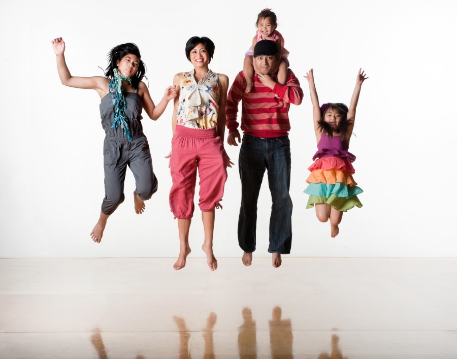 Family of five jumping