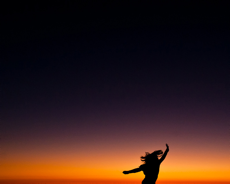 AM silhouette jump during the sun setting over Ocean Beach